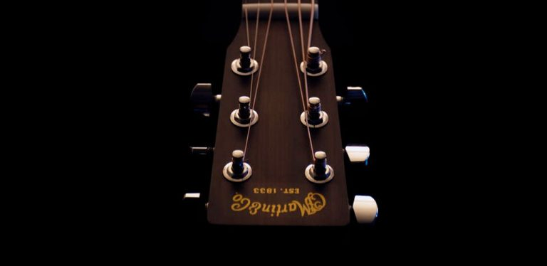 How often should you change your strings on an acoustic guitar?
