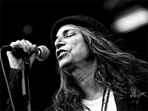 Patti Smith using a Shure SM57 Dynamic Microphone